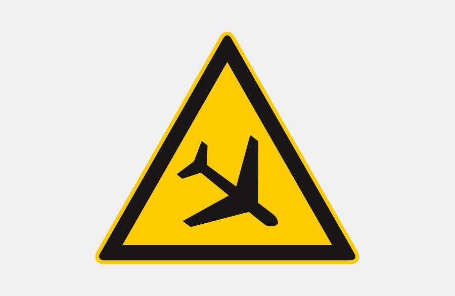 Vorsicht Luftfracht - Flugzeug in einem gelben Dreieck