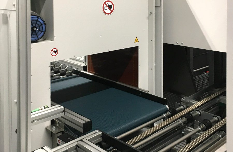 High performance demagnetizer HLE in fully automated cleaning plant. Demagnetizing of washing baskets which are transported by a conveyor belt into the demagnetizer HLE.